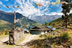 Prayer wall, flags and village in Nepal Royalty Free Stock Photo