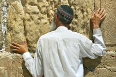 Prayer at the Western Wall. JERUSALEM - AUG 18: Unidentified person praying at Western Wall aka Wailing Wall during Tisha B'Av fast day before major Stock Images