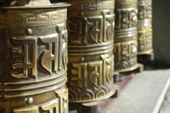 Prayer wheel. S in front of temple Stock Image