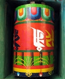 Prayer wheel. Buddhist prayer wheel painted in wood Stock Photography