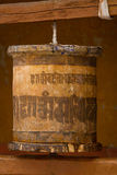 Prayer wheel. Old wooden prayer wheel in Likir Gompa, Ladakh, India Royalty Free Stock Photo