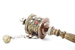 Prayer wheel. A buddish prayer wheel isolated on white background Stock Photography