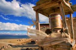 Prayer wheel on the banks of Lake Manasarovar. Tibet Royalty Free Stock Images