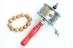 Prayer wheel and beads Stock Image