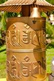 Golden Buddhist prayer wheel at Nanshan Buddhism Center. Hainan, Sanya. royalty free stock photo