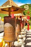 Buddhist prayer wheels in front of the temple are jade-gold statues of the goddess Guanyin in the Nanshan Buddhism Center. Hainan, stock image