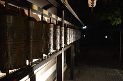 Prayer Wheel. Found these prayer wheels while exploring a temple in Japan at night Stock Images