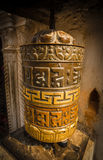 The prayer wheel the iconic symbol of Mantra Buddhism. A prayer wheel is a cylindrical wheel made from metal, wood, stone, leather or coarse cotton Stock Photo