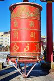 Prayer wheel inside the pagoda in Buddhist complex Golden Abode of Buddha Shakyamuni in spring. Elista. Russia. Prayer wheel inside the pagoda in Buddhist stock photo