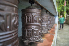 Prayer wheel. JIRI, NEPAL – CIRCA OCTOBER 2013: prayer wheel used in Tibetan Buddhism to the rotational axis of the cylinder inscribed with mantras surface Royalty Free Stock Image