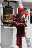 Prayer Wheel and Lady at Bodnath Stock Photography