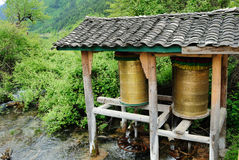 Prayer Wheel Mill. In the Tibetan religion, a prayer wheel mill a characteristic building, which uses the water flowing under the mill to turn the prayer wheel Stock Image
