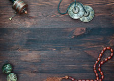 Prayer wheel, prayer beads, magic balls and brass plates for rel Royalty Free Stock Images