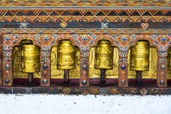 Prayer wheel. Rolling prayer wheel of Bhutan stock photo