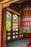 School of the Buddhist religion - Chorten Kora , Bhutan. Prayer wheel and temple at the school of the Buddhist religion near Chorten Kora - Bhutan Royalty Free Stock Photos