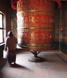 Prayer wheel. Women using the Prayer wheel Royalty Free Stock Images