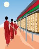 Prayer wheels. An illustration of tibetan monks spinning prayer wheels under a blue sky Stock Photos