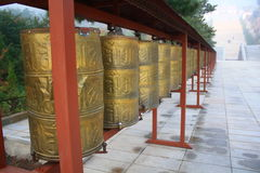 Prayer Wheels. In front of temple Stock Photography