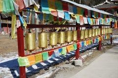 Prayer wheels. Prayer flags  and  prayer wheels  in Jiuzhaigou Zechawa village,Sichuan,China Royalty Free Stock Image