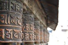 Prayer Wheels. Close up of a row of Prayer Wheels, Kathmandu, Nepal Stock Images