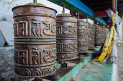 Prayer Wheels. Ancient prayer wheels in Lo Mantang in the upper Mustang region of Nepal Stock Images