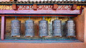 Prayer Wheels. Ancient prayer wheels in Lo Mantang in the upper Mustang region of Royalty Free Stock Images