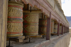 Prayer wheels aside Wanla Gompa, Ladakh Royalty Free Stock Photography