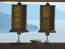 Prayer wheels. With blue skyline and mountains in the background Royalty Free Stock Image
