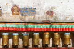 Prayer wheels and Buddhist Scriptures Royalty Free Stock Photography
