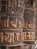 Prayer wheels in buddhist temple. In Nepal Royalty Free Stock Photography