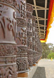 Prayer wheels at a buddhist temple Stock Photo