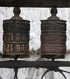 Prayer wheels with Chenrezig mantra, Nepal. Prayer wheel at the Swayambhunath, an ancient religious complex atop a hill in the Kathmandu Valley, Nepal. This Stock Photo