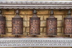 Prayer wheels with Chenrezig mantra, Nepal Royalty Free Stock Images