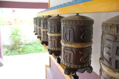Prayer wheels. Prayer drums are standing in a row Stock Photography