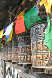 Prayer wheels and flags. Image taken at the Swayambhunath temple, Kathmandu. Selective focus Royalty Free Stock Images
