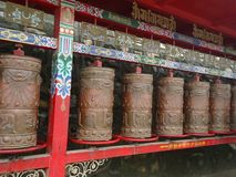 Prayer wheels in front of Ta`er Temple in Xining, China stock image