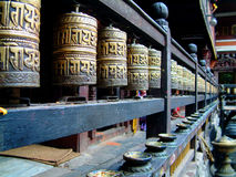 Prayer wheels, Hiranya Verna Mahavihar, Patan (Lalitpur), Nepal. Prayer wheels at the Hiranya Verna Mahaviha temple in Patan, Nepal Stock Photo