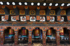 Prayer wheels in the Kyichu Lhakhang temple in Paro Valley, Bhutan Royalty Free Stock Image