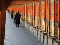 Prayer wheels, Labrang monastery, Xiahe, China. Labrang monastery in Xiahe is one of the six main monasteries of the Geluk (Yellow Hat) sect of Tibetan Buddhists Royalty Free Stock Images