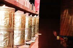 Prayer wheels in a lamasery Royalty Free Stock Photo