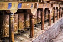 Prayer wheels , Mani wheels , Tibet. Prayer wheels of Tibet . 'The School of Shakyamuni sutra, volume 3 – pagoda and temple' which states royalty free stock photo