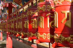 Prayer wheels with mantra, Sanskrit text Royalty Free Stock Image
