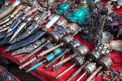 Prayer wheels and Nepali knives Stock Photo