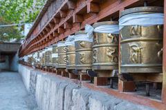 Prayer wheels, prayer's rolls of the faithful Buddhists.Line of Royalty Free Stock Images