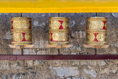 Prayer wheels, prayer's rolls of the faithful Buddhists.Line of Royalty Free Stock Photo