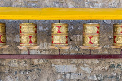 Prayer wheels, prayer's rolls of the faithful Buddhists.Line of Stock Image