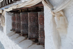 Prayer Wheels and scarves Royalty Free Stock Photography