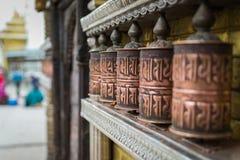 Prayer wheels at Swayambhunath in Kathmandu, Nepal.Selective foc Stock Images