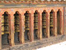 Prayer Wheels. In the Tashichhoedzong (Thimphu Dzong), a Buddhist monastery and fortress on the northern edge of the city of Thimphu in Bhutan Stock Photo
