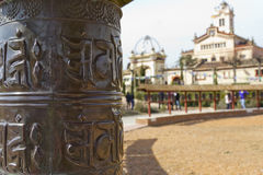 Prayer wheels and temple Royalty Free Stock Photo